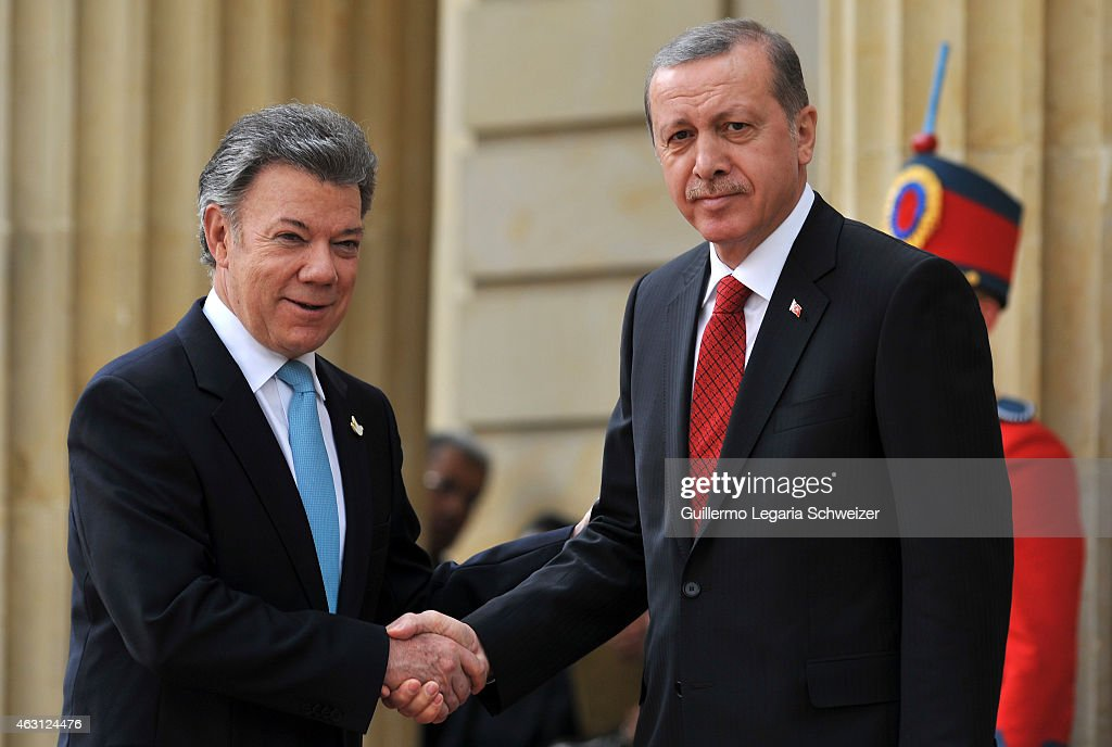 Turkish president Recep Tayyip Erdoga shakes hands with Juan Manuel Santos president of Colombia (L) at Narino Presidential Palace during a two days official visit to Colombia on February 10, 2015 in Bogota, Colombia.