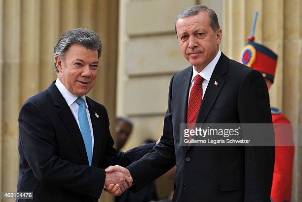 Turkish president Recep Tayyip Erdoga shakes hands with Juan Manuel Santos president of Colombia at Narino Presidential Palace during a two days...