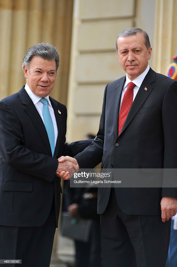 Turkish president Recep Tayyip Erdoga shakes hands with Juan Manuel Santos president of Colombia (L) upon he arrives at Narino Presidential Palace for a meeting during a two days official visit to Colombia on February 10, 2015 in Bogota, Colombia