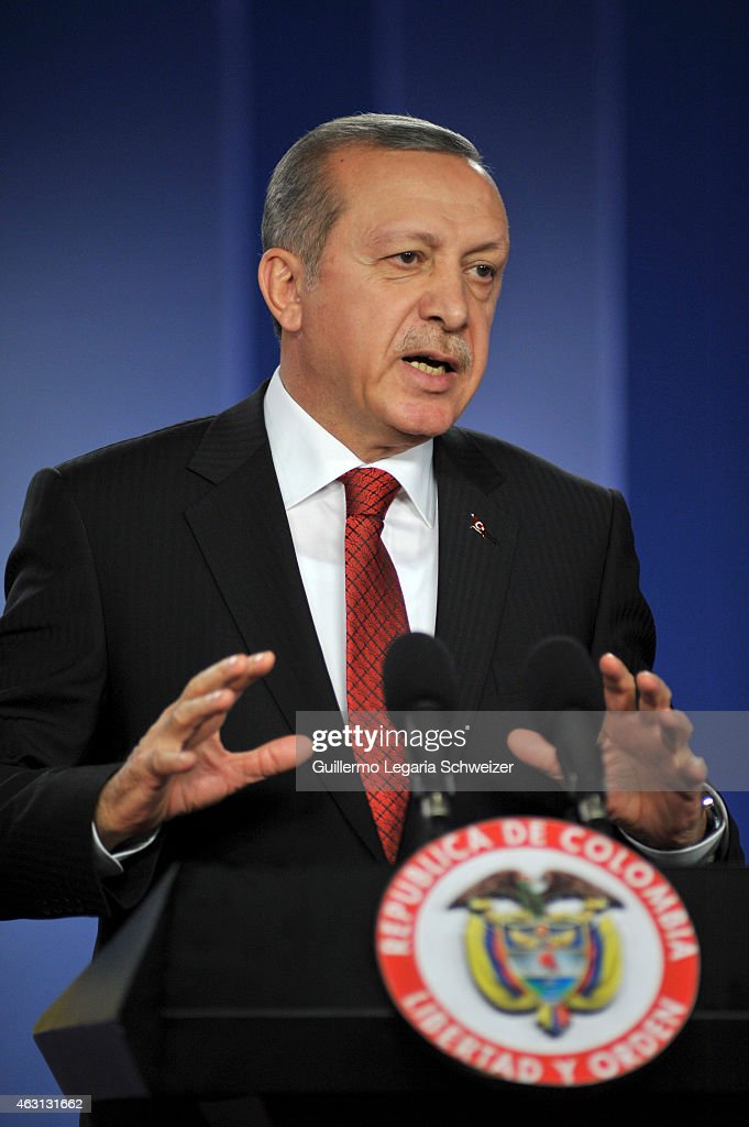 Turkish president Recep Tayyip Erdoga speaks during a joint press conference with Colombian president Juan Manuel Santos (out of frame) after a meeting at Narino Presidential palace on February 10, 2015 in Bogota, Colombia. Turkish president is on a two day official visit to Colombia.