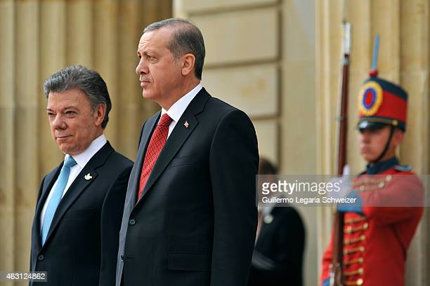Turkish president Recep Tayyip Erdoga stands next to Juan Manuel Santos president of Colombia upon he arrives at Narino Presidential Palace for a...