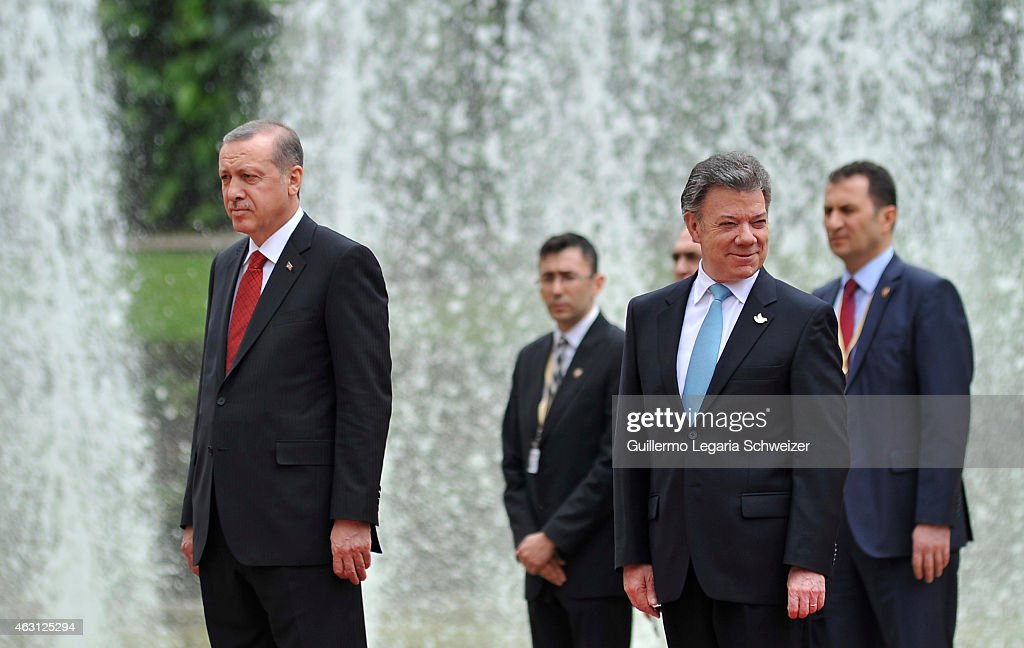 Turkish president Recep Tayyip Erdoga (L) stands next to Juan Manuel Santos president of Colombia (R) during a welcoming ceremony upon he arrives at Narino Presidential Palace for a meeting during a two days official visit to Colombia on February 10, 2015 in Bogota, Colombia
