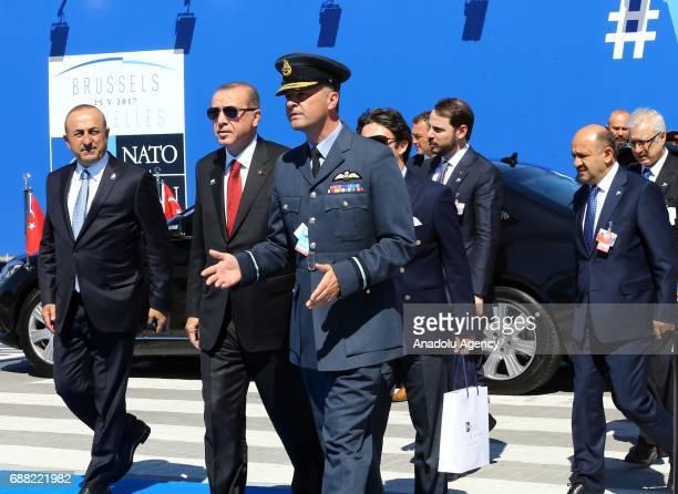 Turkish President Recep Tayyip Erdogan accompanied by Foreign Affairs Minister of Turkey Mevlut Cavusoglu Turkish Defense Minister Fikri Isik and...