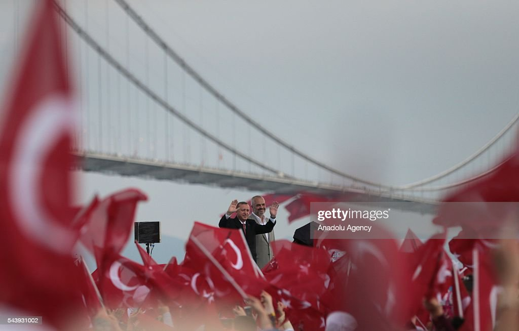 Turkish President Recep Tayyip Erdogan (L) and Albanian Prime Minister Edi Rama (R) greet people during the opening ceremony of Osmangazi Bridge in Kocaeli, Turkey on June 30, 2016. Osmangazi Bridge is the fourth-longest suspension bridge in the world and second-longest bridge in Europe.