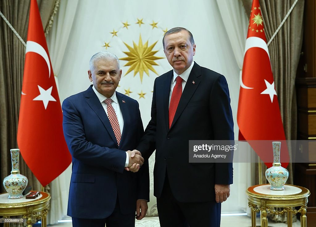 Turkish President Recep Tayyip Erdogan (R) and Chairman of the Turkey's ruling Justice and Development (AK) Party Binali Yildirim (L) shake hands at Presidential Complex, in Ankara, Turkey on May 24, 2016.