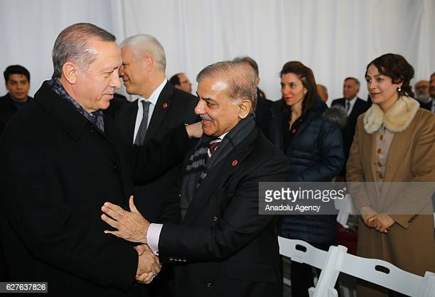 Turkish President Recep Tayyip Erdogan and Chief Minister of Punjab Shehbaz Sharif shake hands during the opening ceremony of Abdullah Gul Museum and...