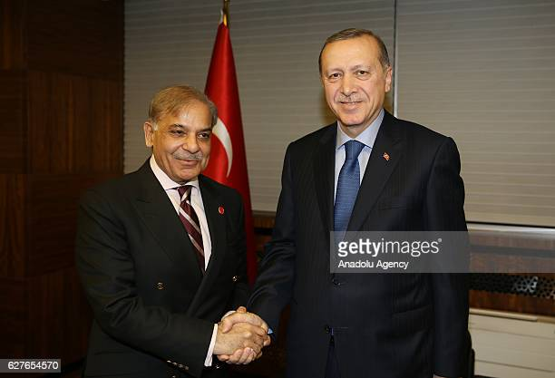 Turkish President Recep Tayyip Erdogan and Chief Minister of Punjab Shehbaz Sharif shake hands during their meeting at Kayseri Metropolitan...