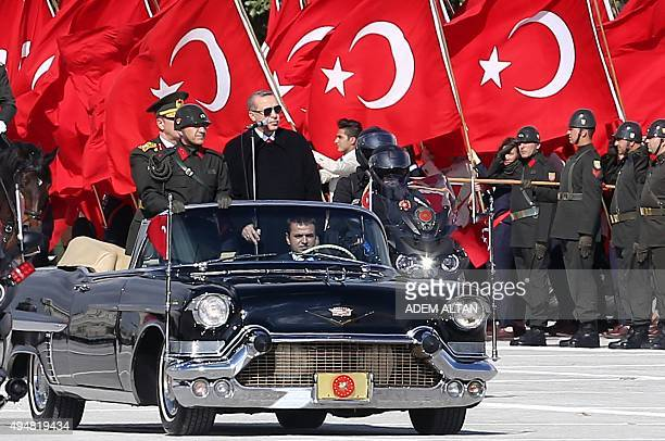 Turkish President Recep Tayyip Erdogan and Chief of the General Staff of the Turkish Armed Forces Hulusi Akar are driven in a car past Turkish...