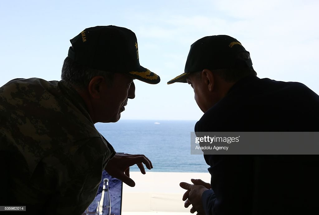 Turkish President Recep Tayyip Erdogan (R) and Chief of the General Staff of the Turkish Armed Forces, Hulusi Akar (L) attend the Efes-2016 Combined Joint Live Fire Exercise at Seferihisar district of Izmir, Turkey on May 31, 2016. The Turkish-led multinational military exercises, Efes-2016 which started at 04 May and will be finished at 04 June 2016, aims to train participating units and staff in planning and conducting combined and joint operations, including logistics and command-control as well as to improve the level of interoperability among headquarters and forces.