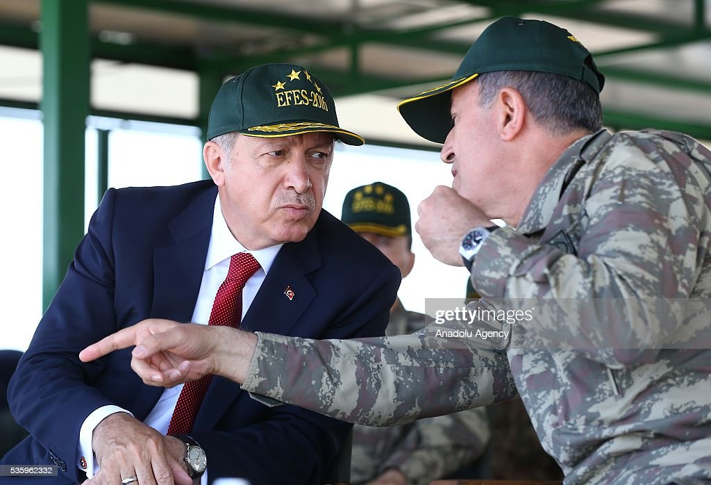 Turkish President Recep Tayyip Erdogan (L) and Chief of the General Staff of the Turkish Armed Forces, Hulusi Akar (R) attend the Efes-2016 Combined Joint Live Fire Exercise at Seferihisar district of Izmir, Turkey on May 31, 2016. The Turkish-led multinational military exercises, Efes-2016 which started at 04 May and will be finished at 04 June 2016, aims to train participating units and staff in planning and conducting combined and joint operations, including logistics and command-control as well as to improve the level of interoperability among headquarters and forces.