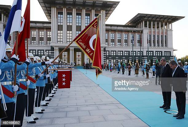 Turkish President Recep Tayyip Erdogan and Finland President Sauli Niinisto inspect the honor guard during an official welcoming ceremony at the...