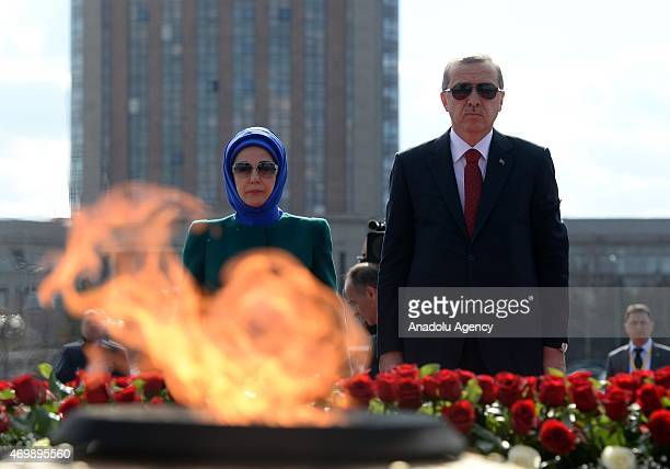 Turkish President Recep Tayyip Erdogan and his wife Emine Erdogan observe a moment of silence after laying a wreath at the Monument of the Motherland...