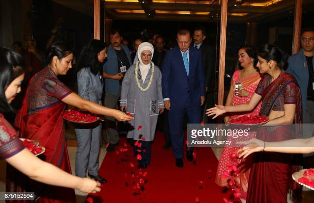 Turkish President Recep Tayyip Erdogan and his wife Emine Erdogan are welcomed by officials before his entry to hotel ahead of his official meetings...