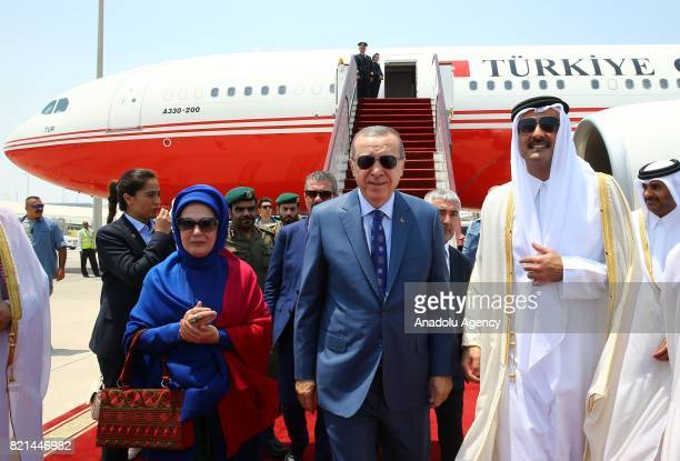Turkish President Recep Tayyip Erdogan and his wife Emine Erdogan are welcomed by Emir of Qatar Sheikh Tamim bin Hamad Al Thani in Doha Qatar on July...