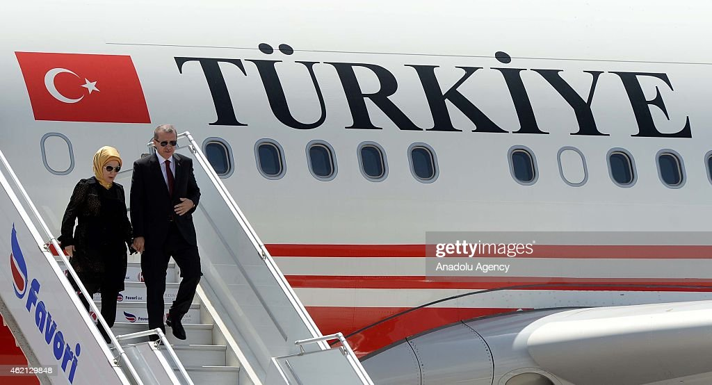 Turkish President Recep Tayyip Erdogan (R) and his wife Emine Erdogan (L) step out of their plane at the airport in Mogadishu, Somalia on January 25, 2015.