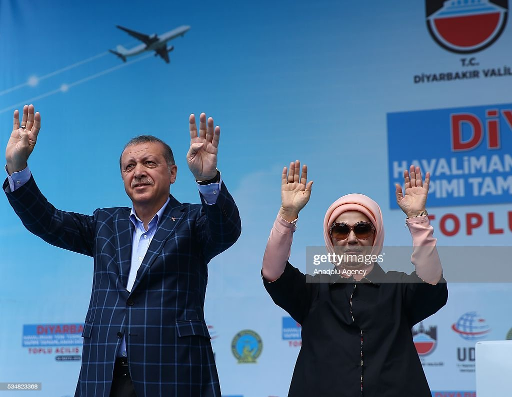 Turkish President Recep Tayyip Erdogan and his wife Emine Erdogan gesture with 'Rabia sign' during an opening ceremony in Diyarbakir, Turkey on May 28, 2016.