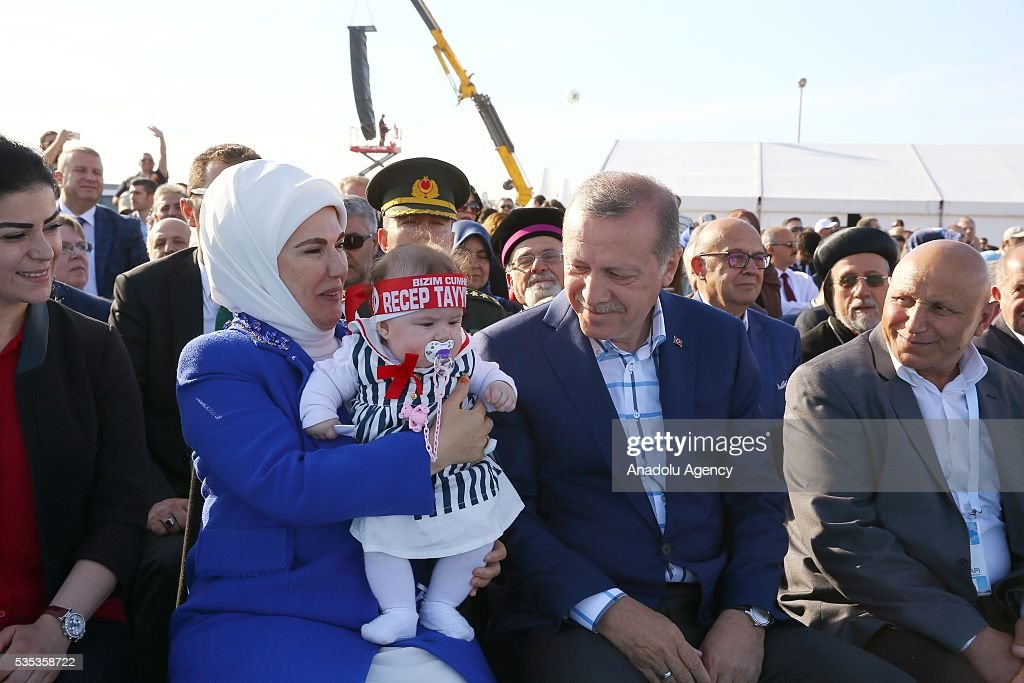 Turkish President Recep Tayyip Erdogan (2nd R) and his wife Emine Erdogan (2nd L) take care with a baby during the celebrations of the 563rd anniversary of Istanbuls conquest by Turks at Yenikapi Event Area in Istanbul, Turkey on May 29, 2016. On May 29, 1453, Ottoman Sultan Mehmed II (Mehmet the Conqueror) conquered Istanbul, then called Constantinople, from where the Byzantines had ruled the Eastern Roman Empire for more than 1,000 years. The conquest transformed the city, once the heart of the Byzantine realm, into the capital of the new Ottoman Empire.