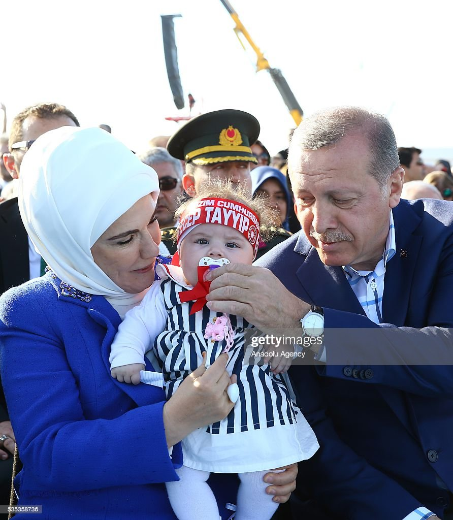 Turkish President Recep Tayyip Erdogan (R) and his wife Emine Erdogan (L) take care with a baby during the celebrations of the 563rd anniversary of Istanbuls conquest by Turks at Yenikapi Event Area in Istanbul, Turkey on May 29, 2016. On May 29, 1453, Ottoman Sultan Mehmed II (Mehmet the Conqueror) conquered Istanbul, then called Constantinople, from where the Byzantines had ruled the Eastern Roman Empire for more than 1,000 years. The conquest transformed the city, once the heart of the Byzantine realm, into the capital of the new Ottoman Empire.