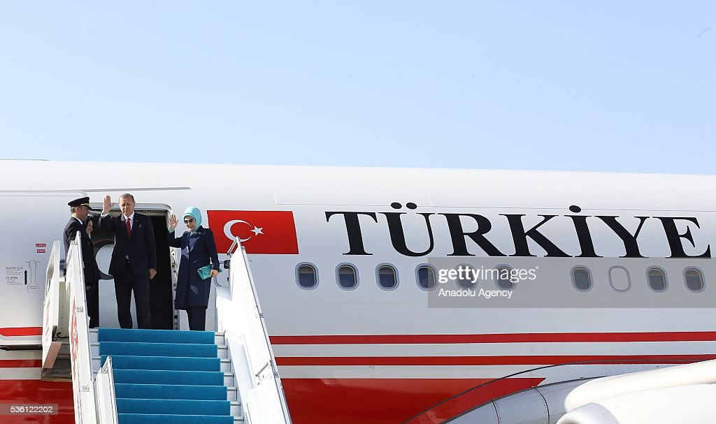 Turkish President Recep Tayyip Erdogan and his wife Emine Erdogan wave hands at the Izmir Adnan Menderes Airport in Izmir, Turkey on May 31, 2016 before their visit to Uganda.