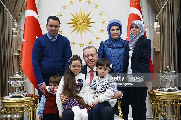 Turkish President Recep Tayyip Erdogan and his wife Emine Erdogan pose with Syrian Bana Alabed sevenyearold girl who tweeted on attacks from Aleppo...