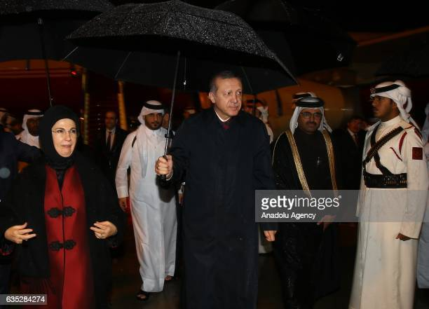 Turkish President Recep Tayyip Erdogan and his wife Emine Erdogan leave the plane as they arrived in Doha Qatar on February 14 2017 prior to an...