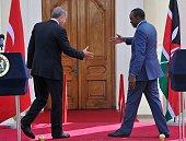 Turkish President Recep Tayyip Erdogan and Kenyan President Uhuru Kenyatta reach out for a handshake after a joint press confence on June 2 2016 at...