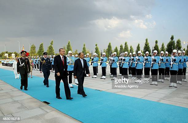 Turkish President Recep Tayyip Erdogan and New Zealand's GovernorGeneral Jerry Mateparae attend an official welcoming ceremony at the Presidential...