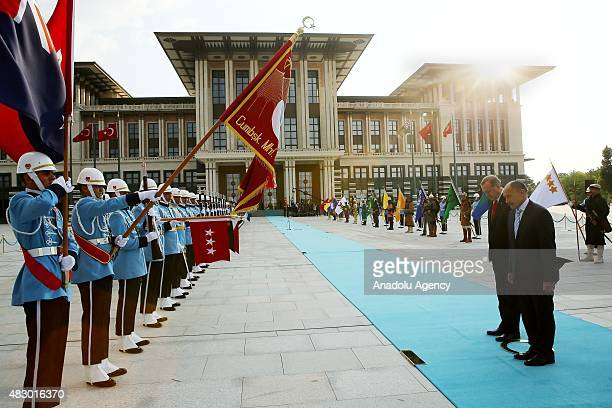 Turkish President Recep Tayyip Erdogan and New Zealand's GovernorGeneral Jerry Mateparae greet guard of honor during an official welcoming ceremony...