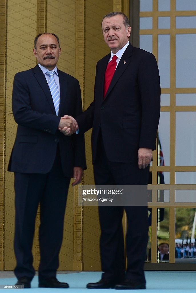 Turkish President Recep Tayyip Erdogan and New Zealand's GovernorGeneral Jerry Mateparae shake hands during an official welcoming ceremony at the...
