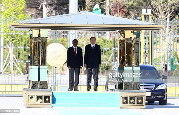 Turkish President Recep Tayyip Erdogan and President of Somalia Mohamed Abdullahi Mohamed stand in silence during an official welcoming ceremony at...