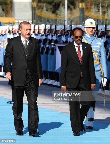 Turkish President Recep Tayyip Erdogan and President of Somalia Mohamed Abdullahi Mohamed walk past the honor guards during an official welcoming...