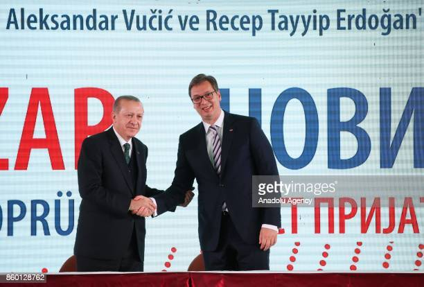 Turkish President Recep Tayyip Erdogan and Serbian President Aleksandar Vucic shake hands as they pose for a photo in Novi Pazar Serbia on October 11...