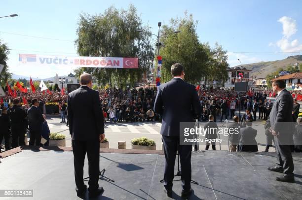 Turkish President Recep Tayyip Erdogan and Serbian President Aleksandar Vucic make a speech in Novi Pazar Serbia on October 11 2017