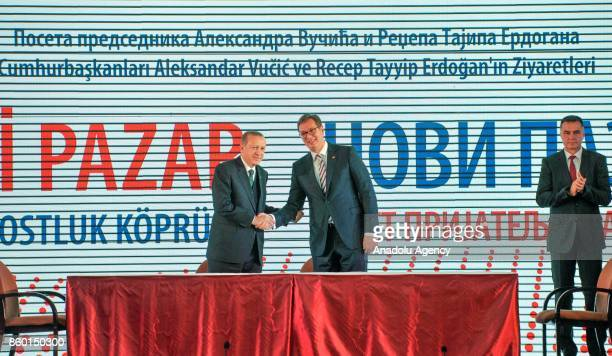 Turkish President Recep Tayyip Erdogan and Serbian President Aleksandar Vucic shake hands as they pose for a photo ahead of the signing ceremony of...
