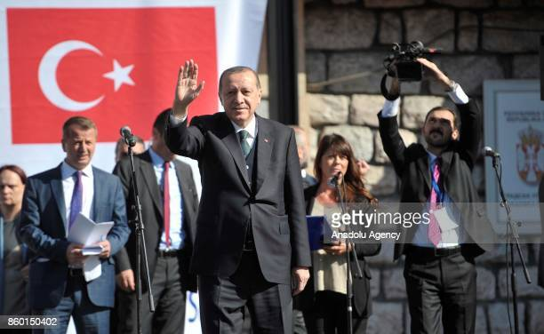 Turkish President Recep Tayyip Erdogan and Serbian President Aleksandar Vucic greet citizens before making a speech in Novi Pazar Serbia on October...