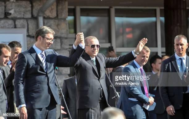 Turkish President Recep Tayyip Erdogan and Serbian President Aleksandar Vucic greet citizens together in Novi Pazar Serbia on October 11 2017