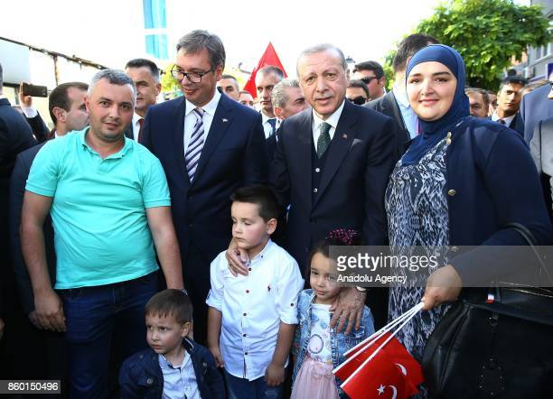 Turkish President Recep Tayyip Erdogan and Serbian President Aleksandar Vucic pose for a photo with citizens during their visit in Novi Pazar Serbia...