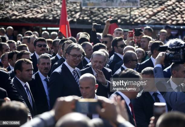 Turkish President Recep Tayyip Erdogan and Serbian President Aleksandar Vucic greet people during their visit to southern Muslimmajority city of Novi...
