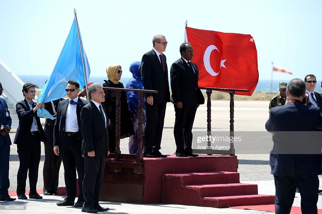 Turkish President Recep Tayyip Erdogan (L) and Somalian President Hassan Sheikh Mohamoud (R) are seen during an official welcoming ceremony at the airport in Mogadishu, Somalia on January 25, 2015.