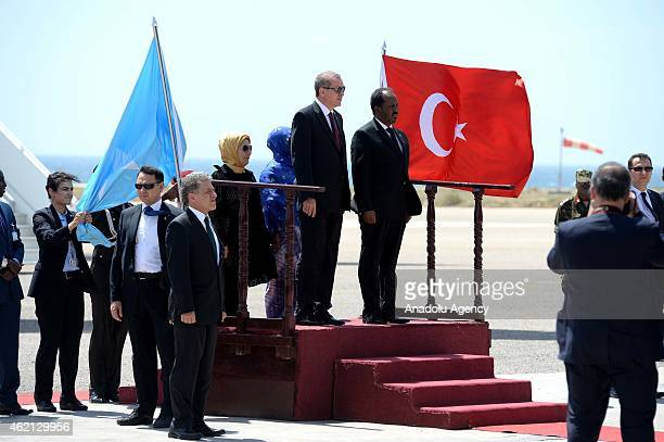 Turkish President Recep Tayyip Erdogan and Somalian President Hassan Sheikh Mohamoud are seen during an official welcoming ceremony at the airport in...