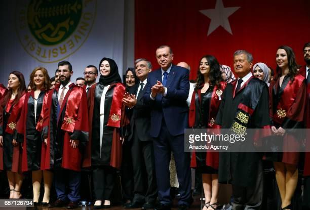 Turkish President Recep Tayyip Erdogan and Turkey's 11th President Abdullah Gul attend a graduation ceremony of Istanbul University faculty of...