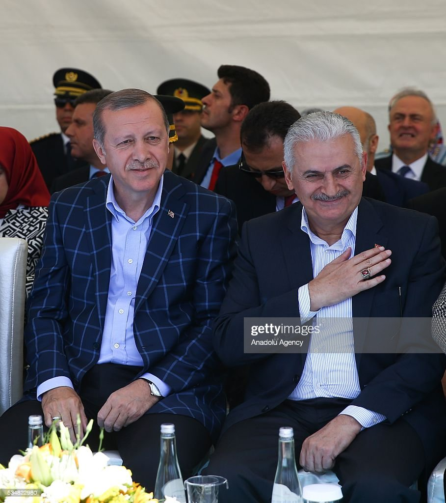 Turkish President Recep Tayyip Erdogan (L) and Turkish Prime Minister Binali Yildirim (R) attend an opening ceremony in Diyarbakir, Turkey on May 28, 2016.
