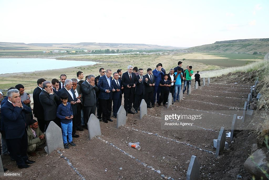 Turkish President Recep Tayyip Erdogan (7th L) and Turkish Prime Minister Binali Yildirim (4th L) pray with citizens during their condolence visit to the graves of the PKK's terrorist attack victims in Tanisik village of Diyarbakir Province of Turkey on May 28, 2016. PKK killed 16 people and injured 23 earlier this month with a bomb-laden truck attack in Durumlu village of Diyarbakir. PKK is recognized as a terrorist organization by several states and organizations, including the North Atlantic Treaty Organisation (NATO) , European Union (EU) and USA and several other countries around the world. PKK has been staged varied terrorist attacks on civilians over 30 years in Turkey and other countries.