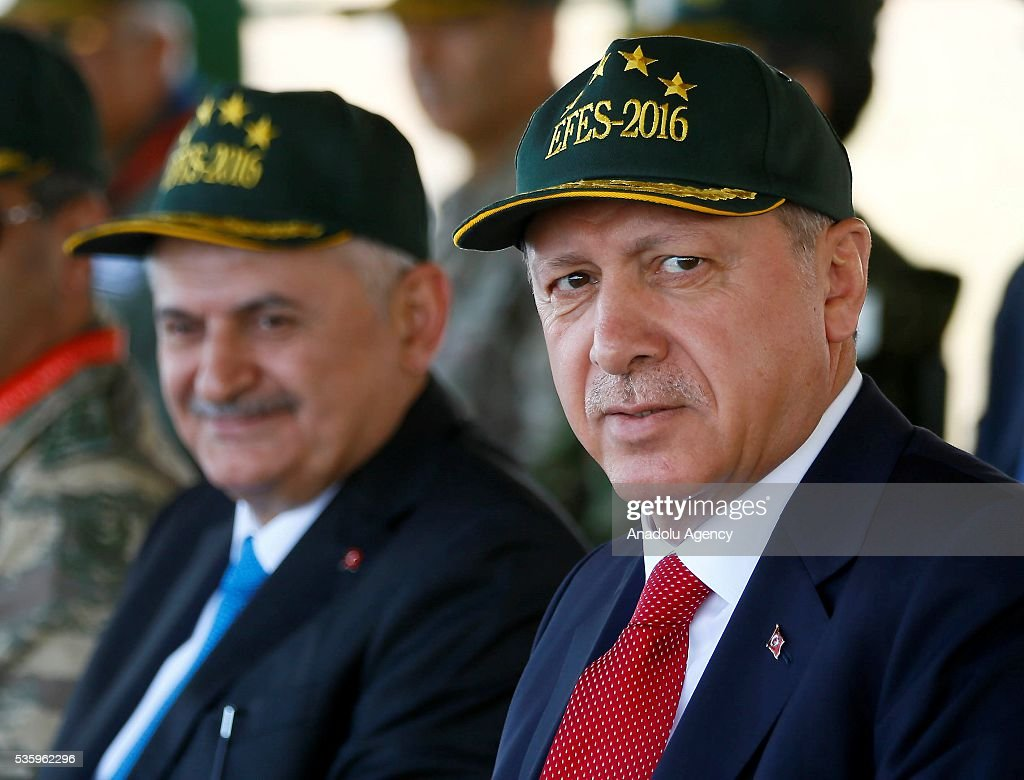 Turkish President Recep Tayyip Erdogan (R) and Turkish Prime Minister Binali Yildirim (L) attend the Efes-2016 Combined Joint Live Fire Exercise at Seferihisar district of Izmir, Turkey on May 31, 2016. The Turkish-led multinational military exercises, Efes-2016 which started on May May 4, will be finished on June 04, 2016, aims to train participating units and staff in planning and conducting combined and joint operations, including logistics and command-control as well as to improve the level of interoperability among headquarters and forces.