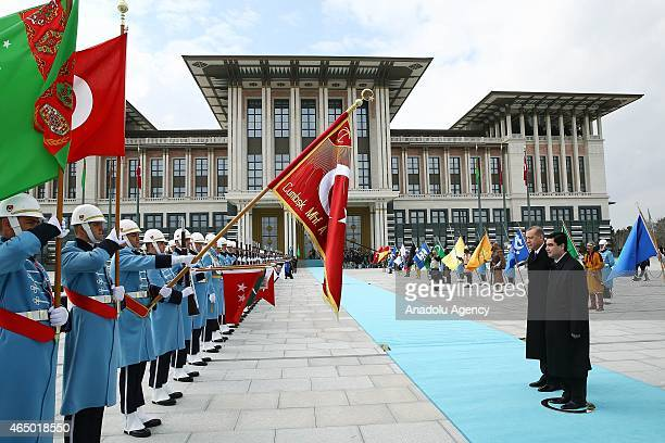 Turkish President Recep Tayyip Erdogan and Turkmenistan's President Gurbanguly Berdimuhamedow review honor guard during an official welcoming...