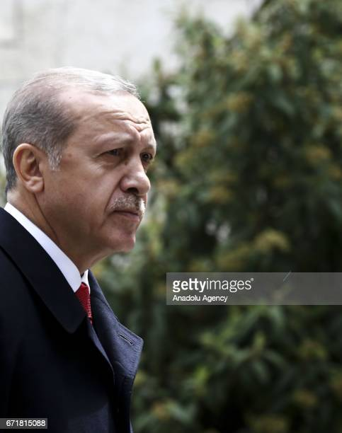 Turkish President Recep Tayyip Erdogan arrives to attend the parliament's special session at TBMM as part of the 97th anniversary of foundation of...