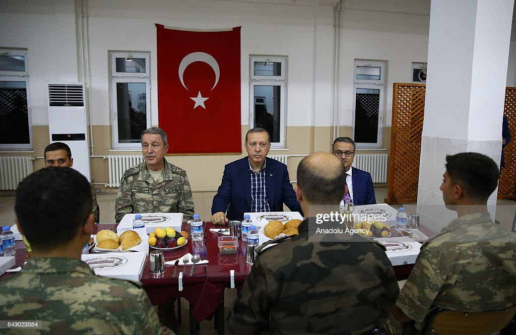 Turkish President Recep Tayyip Erdogan (2nd R) attends an Iftar (fast-breaking) Dinner during his visit at 172. Armored Brigade Command's 3. Tank Battalion campus in Cizre District of Sirnak, Turkey on Islamic holy month Ramadan on June 25, 2016.