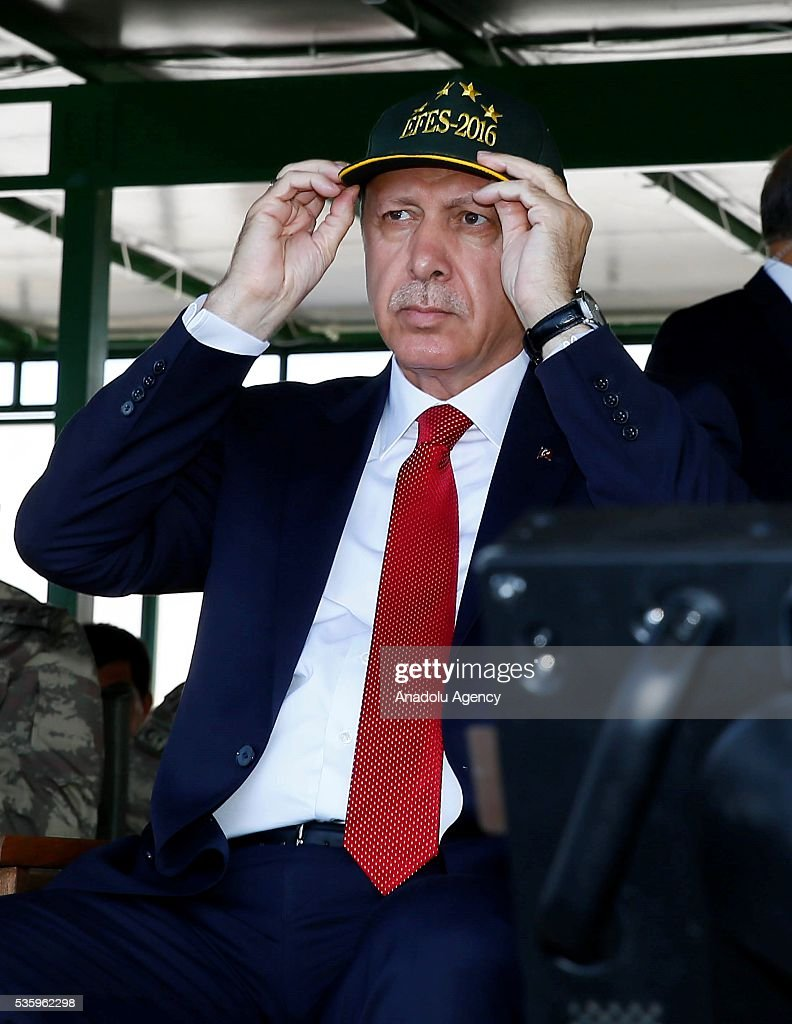 Turkish President Recep Tayyip Erdogan attends the Efes-2016 Combined Joint Live Fire Exercise at Seferihisar district of Izmir, Turkey on May 31, 2016. The Turkish-led multinational military exercises, Efes-2016 which started on May May 4, will be finished on June 04, 2016, aims to train participating units and staff in planning and conducting combined and joint operations, including logistics and command-control as well as to improve the level of interoperability among headquarters and forces.