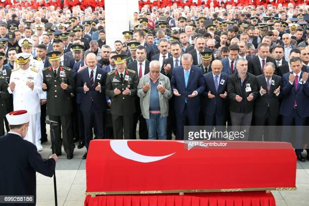 Turkish President Recep Tayyip Erdogan attends the funeral of Turkish Captain Murat Ucoz who was killed during clashes with Kurdistan Workers' Party...