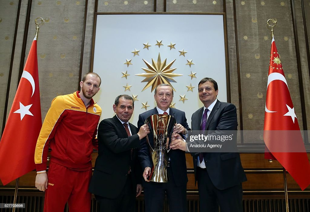 Turkish President Recep Tayyip Erdogan (2 R), Chairman of Galatasaray S.K. Dursun Ozbek (2 L) and Head Coach of Galatasaray Ergin Ataman (R) and Sinan Guler (L) player of Galatasaray Men's Basketball Team pose with champion cup of ULEB Eurocup at Presidential Complex in Ankara, Turkey on May 3, 2016.